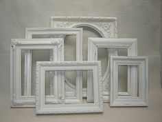 collection of mismatched white picture frames - I did this and hung them on a black painted wall. Amazing.