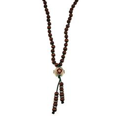 Boho necklace with tibetan pendant element and wood beads