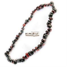 Adults can enjoy wearing baltic amber with this 45 cm long bud amber necklace in Dark Cherry colour beads. Match your baby with their Baby bud necklace! Extra lengths are available in 50cm and 55cm.    While Bambeado amber comes in several colours, the colour is just a matter of personal choice. The colours may vary slightly from the images on the website due to variations in the amber beads. Each amber necklace is unique.