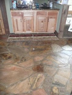 One is that irregular slate flagstone is often used for indoor floors. If can be really rustic, like this: