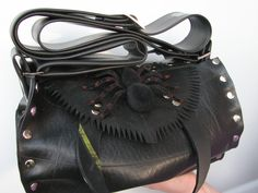 Our Spider adorned large handbag was a frighteningly well thought out design. This bag made from truck inner tube is large enough to fit in everything you might need. It comes with a adjustable strap. Sink your fangs into this one! Looking for spider designs on the World Wide Web? Look no further! This spider bag can also be made into the Itsy Bitsy size. :) Come into our parlour and see what else we have in store for you...