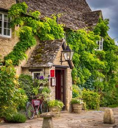 The Old Swan Inn in the little Cotswold village of Minster Lovell, Oxfordshire, England.