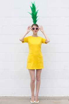 DIY Pineapple Costume dye up a yellow shirt or dress (maybe stamp some texture on their for extra fun) and make this cute ah hat (?) for the full effect!