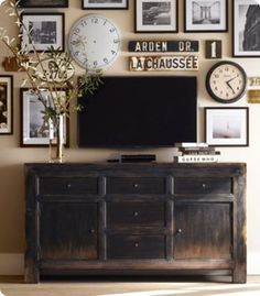 Create a Gallery Wall Around the TV (use cheap dollar store frames and eclectic vintage finds to take focus from the TV ... use black and white or bright and colorful prints depending on the feel you want)