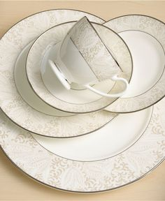 """""""Bassano"""" leaf and tulip patterns with raised dots — bone china dinnerware place setting by Waterford"""