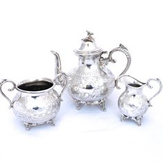 Vintage three piece silver plated tea set.  Set is made up of a teapot, handled sugar bowl, and milk/creamer jug.  All items have a chased swirl design around sides and stand on ornate feet.  No makers mark. So date of manufacturer is unknown. Set has a great Antique/Victorian style to it, but is most likely a later reproduction piece.  Teapot is marked Best electro plate  Teapot with lid 8 (20cm) tall 5 (12.5cm) diameter 8.5 (21.5cm) handle to spout  Milk jug 4.5 (11.5cm) tall 4 (...