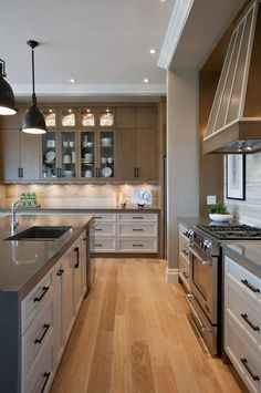 I like the transitional cabinet design, and interesting use of white lowers, beige uppers with great framing of the white.