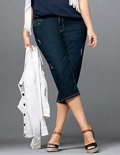 In a trendy dark wash denim our classic-fit capri lets you always look your best with Tighter Tummy Technology! The higher rise and interior tummy control panels keep your midsection looking smooth, with a hidden elastic waist band for a no-gap fit. #LaneBryant