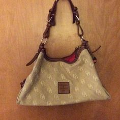 Dooney & Bourke Purse DB medium size over shoulder purse. Tan & Cream with red inside. Dooney & Bourke Bags