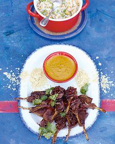 lamb lollipops, curry sauce, rice & peas
