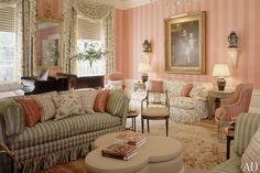 Browne decorated the living room of an 1815 house in Washington, D.C., with raspberry-striped walls, a profusion of printed and woven fabrics, and a flowered Napoléon III carpet from F. J. Hakimian. (February 1993)