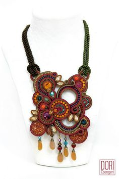 statement necklaces : Phoenix Statement Necklace    Show stopping fall colors oversized necklace by Dori Csengeri Phoenix Statement Necklace Style No. PHN-N374 Price: $1,268  Show stopping handmade necklace with Swarovski crystals, crystal cup chains, glass drops, Swarovski laser fused crystals elements, glass gems, woven textile cords, glass & miyuki beads * necklace size 46 cm * center element 18 cm x 12 cm * 2 buttons clasp