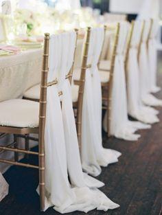 Grecian-style draping on gold #chivari chairs I Elle Ellinghaus Designs I #chairdecor