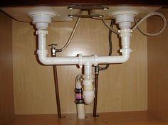 plumbing under kitchen sink fresh on