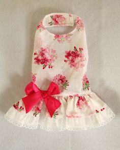 Pink & White Party Dog Dress - Beautiful Dog Dress for special occasions - Lightweight for summer - Delicate pink flowers on a white background - Dropwaist style - Underskirt with pretty white lace - Large bright pink bow at waist - It easily attaches with adjustable velcro neck and belly straps - Open chest design