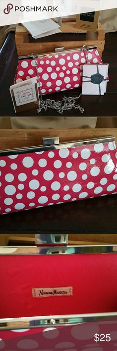Neiman Marcus Beauty Bag This fun, pink polka dot clutch with silver clasp & silver hide-a-way chain filled with awesome perfume samples is the Neiman Marcus Spring 2017 beauty event bag. ALL NEW - NEVER USED. Only removed perfume from bag for photos. Neiman Marcus Bags Clutches & Wristlets
