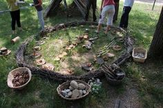 I find this image quite striking. The use of branches placed in a circle to frame the outdoor play space. There is a variety of materials to use, offering different textures, and sizes.