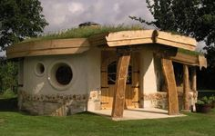 Cob Building. Earthed was contracted by Slimbridge WWT to build a cob and timber frame viewing gallery to house a new exhibition of wetland mammals. The cob walls in combination with a timber frame structure supports a ˜living roof of wild flowers and are finished with a lime plaster and earthen render. earthedworld.co.uk