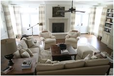 casual, comfortable family room, fireplace, bookcases (Urban Grace Interiors)