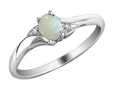 Opal...freaking gorgeous.  I've always hated the idea of girls having a set idea of what their engagement ring would be, but this ring change my views on that.  I would LOVE this for such occasion.