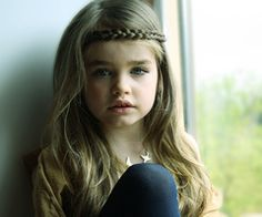 long haired child. I wish my kids had hair! hah
