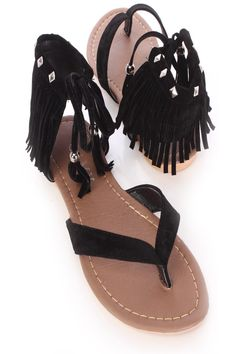 Slip into these adorable sandals with your next favorite outfit! Make sure to add these to your collection, it definitely is a must have! The features include a faux suede upper with a V strap vamp and thong post, ankle cuff with fringe trim and front tie closure with beaded tassels, studded detailing, stitched trim, smooth lining, and cushioned footbed.