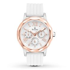 Sporty elements blend with timeless elegance in this clean-lined women's watch by Bulova. A 38mm rose-gold-tone stainless steel case holds a white dial with rose-gold-tone hands and indexes. Topped with a mineral crystal to protect the movement, the case is affixed to a white rubber strap. The watch is water-resistant to 200 meters. Please note: Due to a recent redesign by Bulova, the watch you receive may not feature the Bulova tuning fork logo on the watch face.