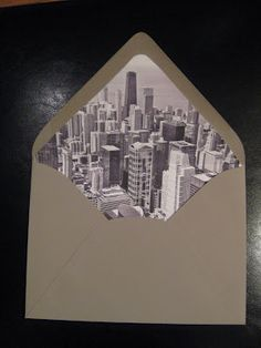DIY Photo Envelope Liner Tutorial (on weddingbee.com) - such a great way to add personality to the whole event. would be awesome with newspaper or magazine pages, too.