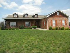 #KellerWilliams #RealEstate 400 Scenic, Saddlebrooke, MO MLS 354961  Beautiful three bedroom and two and a half bath home with gorgeous views of the Ozark Mountains and over 2200 sq ft. This home sits on corner lot in Saddlebrooke. When you walk in this home you see the wood floors, a gas fireplace in the living room, and granite counter tops in the kitchen. Step out the back deck to a screened porch with a partially fenced back yard for the kids or pets to enjoy.