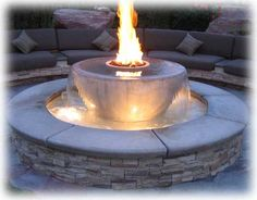 This would be pretty by the pool. I'd like two, one on each longer side, where the current planting circles are located in the pool's concrete deck.. Diy Fire Pit, Fire Pit Backyard, Fire Pits, Cozy Backyard, Backyard Fireplace, Fireplace Ideas, Fireplace Design, Outdoor Fireplaces, Fireplace Lighting