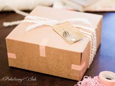 Simple but awesome gift wrapping using a feathered chevron gift tag from Pokeberry Ink Press. Buy a set for $10 on Etsy.