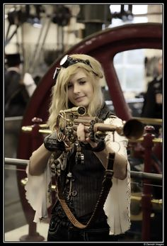 Boyz toyz, and the gun ain't too bad either.  Anime Steampunk Girl | Steampunk @ Bradford Industrial Museum by Dervish Images