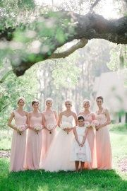 long, flowing light pink bridesmaid dresses.