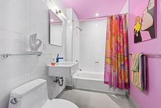 This Brooklyn Apartment Has a Pink Bathroom, a Purple Library, and a Bright Blue Hallway