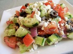 Chunky Greek Salad. I need to make this... but with the skin on! I dunno why everyone cuts the skin off the cucumbers, that's where the nutrients are ;)