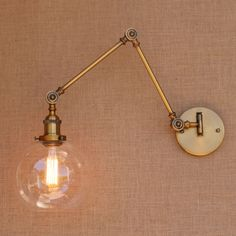 Retro Brass Adjustable Long Arm Wall Lamp Vintage LED Stair Light Loft Style Industrial Wall Sconce -  Item Type: Wall Lamps  Certification: UL,CQC,CE,FCC,EMC,PSE,VDE,CCC  Shade Type: Clear Glass  Power Source: AC  Body Material: Iron  Base Type: E27  Application: Bed Room  Warranty: 3 year  Light Source: LED Bulbs  Is Bulbs Included: No  Installation Type: Wall Mounted  Features: Loft style  Shade Direction: Down  Voltage: 90-260V  Technics: Plated  Style: Vintage  Lighting Area: 5-10square…