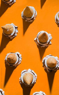 Caramel vanilla and chocolate ice creams on orange background. by Marko Milanovic