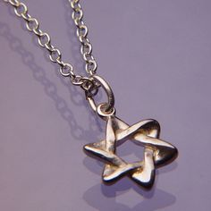 As with many ancient symbols, the origins and derivation of this familiar shape, called the Star of David, are shrouded in mystery and debate. The symbol is seen as early as the the 2nd or 3rd Century BCE but it was not until the middle ages that it gained wide currency as a symbol of Jewish identity. #Hanukkah #gift #gifts #star #starofdavid #Judaica #Jewish #jewelry #necklace