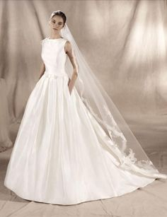 Elegant ballgown wedding dress in royal satin. The bateau neckline merges with the back through the tulle and beaded lace and guipure appliqués. Sincerity Bridal, Bridal Gowns, Wedding Gowns, Wedding Cakes, Sabrina Neckline, Sabrina Dress, Wedding Dress Necklines, Curvy Bride, House Dress