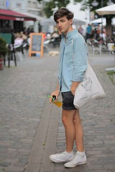 This pairing of a light blue denim shirt and black shorts is solid proof that a simple off-duty look can still look truly sharp. Give a different twist to your ensemble by slipping into white high top sneakers. Summer Outfits Men, Short Outfits, Casual Outfits, Men Casual, White High Top Sneakers, White High Tops, High Top Converse Outfits, Converse Style, Converse Men