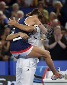 Agnieszka Radwanska of Poland celebrates with Jerzy Janowicz after defeating Serena Williams and John Isner of the United States in the final during day seven of the 2015 Hopman Cup ...