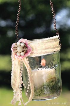 Simple alterations add so much style! We embellished these jars with fabric scraps, beaded trims, altered jewelry components and more. Then we wrapped them with wire and hung them from a branch. Instant outdoor ambiance!