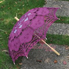 $20 w/ shipping.   eBay -- Wow! I kind of just assumed cute lacey umbrellas would be expensive and hard to find... this sight has a whole bunch of color options and they are all like $12-25!