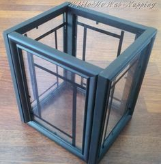 4 Dollar Tree picture frames + glue = lantern.  Add flame burning or flicker candle.
