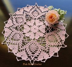 """Our beautiful crochet-a-long hearts doily was first designed as a """"crochet-a-long."""" The pattern is written to include breaks for those wishing to work in segments. With a petite heart center giving way to delicate pineapples and then more hearts, is a favorite!"""