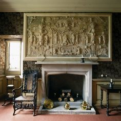 Dunster Castle ~ A close up of the fireplace and palsterwork over the mantelpiece in the King Charles Room. The plasterwork dates from 1620 and depicts the Judgement of Paris.