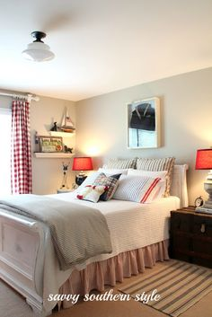 Savvy Southern Style: love this nautical bedroom - especially the framed sailor shirt