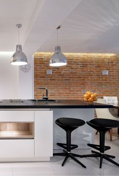 Industrial kitchen design in white with a brick accent wall.  #mortonstones #brick #tiles #rustic #home #decor #brickveneer  #interior #accent #wall #rustic #livingroom