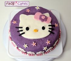 Fascinating Purple Hello Kitty Cake Decorating Idea With White Hello Kitty Motive With Pink Bows And White Pink Flowers - Use J/K to navigate to previous and next images Hello Kitty Fondant, Hello Kitty Birthday Cake, Hello Kitty Cupcakes, Fondant Cakes, Cupcake Cakes, Rose Cupcake, Hello Kitty Crafts, Chocolate Ganache Filling, Chocolate Cake