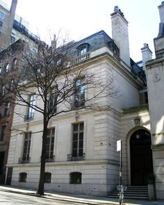 60 East 93rd St.   New York, NY. The 50-room mansion Virginia Graham Fair Vanderbilt commissioned architect John Russell Pope to design following her divorce from William K. Vanderbilt, Jr. Designed as a Louis XV-style limestone palais. Pope designed the house as two separate sections so that Gentry and Servants had no reason to meet unnecessarily. The main house was three stories with 15-foot ceilings. The servants areas had lower ceilings and fit 7-stories into that same height.